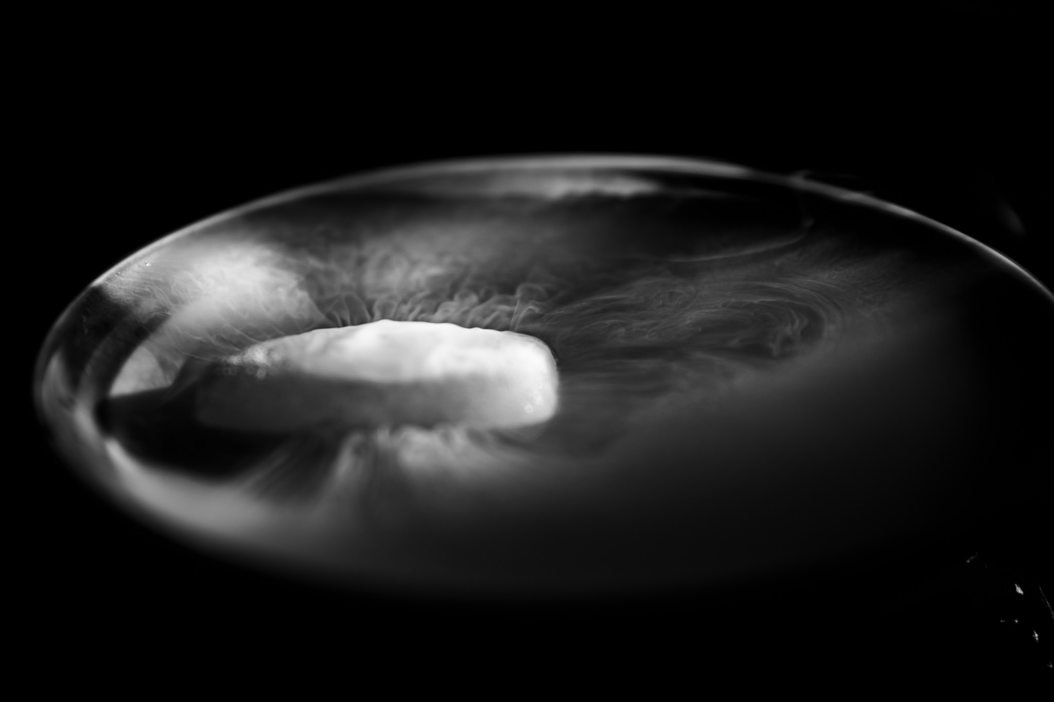 Black and White image of dry ice sublimating.