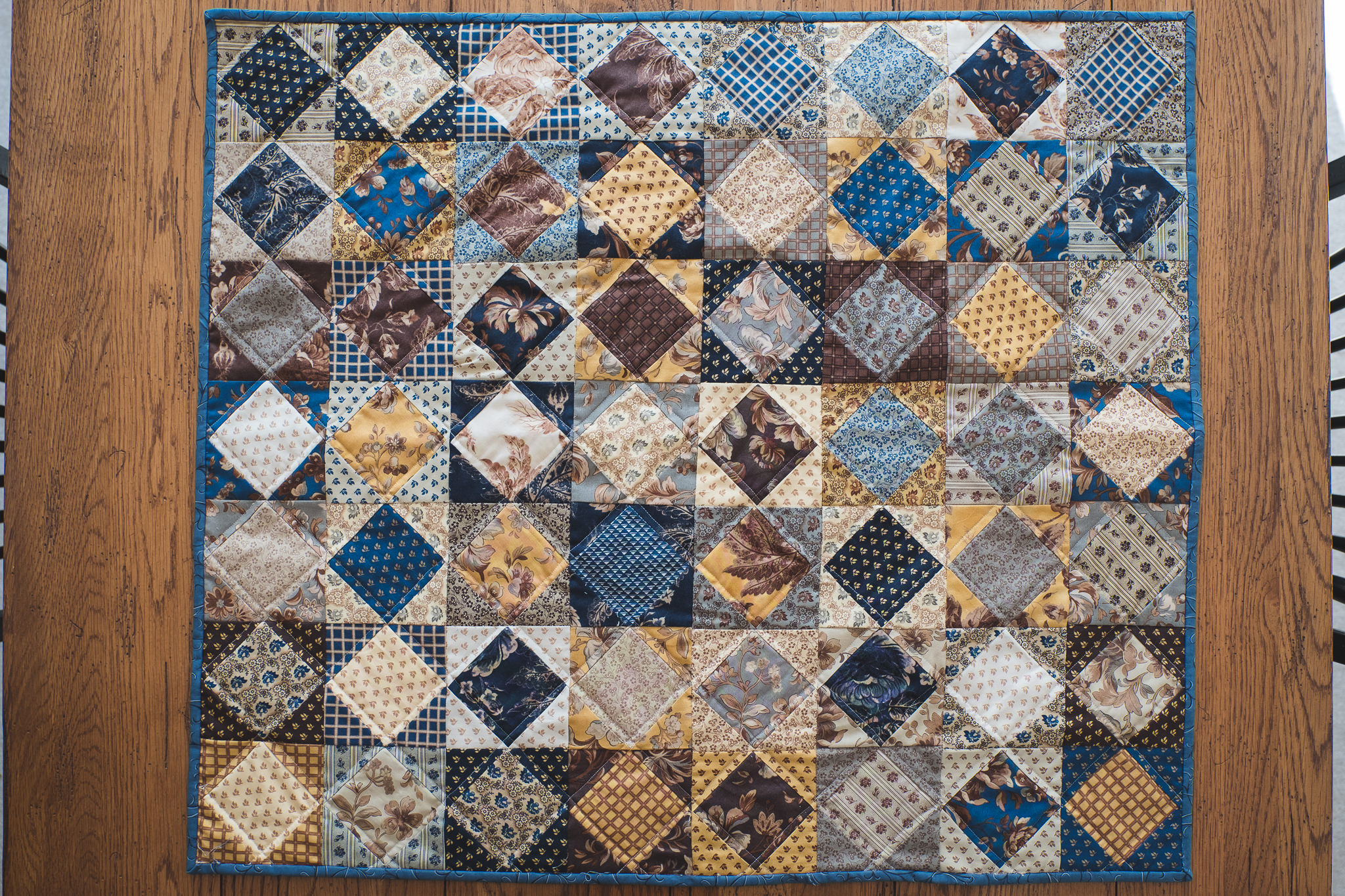 Blue and Brown Quilted Table-Topper